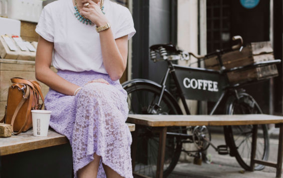 Woman sitting outside of a cafe